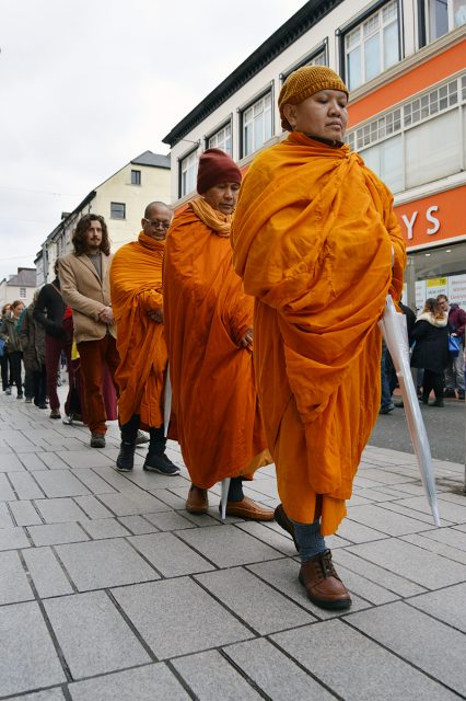 "A Mindful Walking Meditation of people of all traditions, religions and faiths calmed the Saturday hustle and bustle in Corks Patrick Street on Saturday 18th February. This connecting to "" Mother Earth"" was in the Tradition of Buddhist monk Thích Nhất Hạnh. The event was well attended by Christian & Buddhist organisations including Rigpa,Thervada, Zen, & Mindfulness was led by Phramaha Rumpai Kaenkul the Abbot of Wat BuddhaMahaDhatu Temple in Mitchelstown,Conrad Frankel of Plum village and Mary O Connor of the Chinese Hanmi Buddhist Centre. The Mindful Walking Meditation will take place monthly in Cork. Photo: Jason Butler NB No charge for this photo Thich Nhat Hanh on Walking Meditation "" Many of us walk for the sole purpose of getting from one place to another. Now suppose we are walking to a sacred place. We would walk quietly and take each gentle step with reverence. I propose that we walk this way every time we walk on the earth. The earth is sacred and we touch her with each step. We should be very respectful, because we are walking on our mother. If we walk like that, then every step will be grounding, every step will be nourishing."" Walking has been practiced as a meditative technique for thousands of years. Contact details for more info: Conrad Frankel 089 4731643 Mary O Connor 089 4717922 www.esoterichanmi.com www.corkhamni.wordpress.com www.watbuddhamahadhatu.wordpress.com"